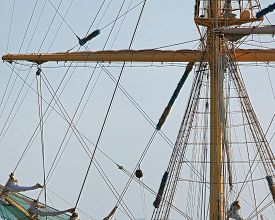 picture of sailing vessels  - the mast of a sailing vessel with removed sails against the sky - JPG