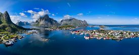 picture of reining  - Breathtaking aerial panorama of fishing town Reine and surrounding fjords on Lofoten islands in Norway famous tourist destination - JPG