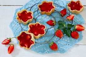 stock photo of shortbread  - cake with strawberry tarts shortbread dough and strawberry jelly - JPG