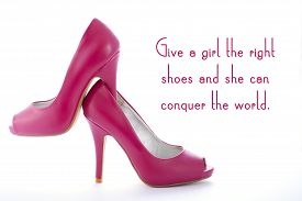 stock photo of stiletto  - Pair of high heel stiletto pink shoes with give a girl the right shoes and she can conquer the world quote on white background - JPG