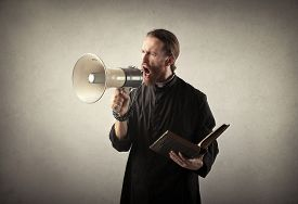 pic of priest  - Priest shouting into a megaphone - JPG