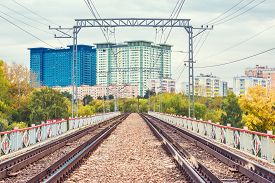 picture of track home  - Railway tracks on the bridge by the apartment buildings - JPG