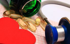 picture of ekg  - Medical stethoscope tablets and heart shape on electrocardiogram graph ekg heart rhythm medicine concept - JPG