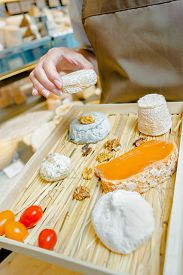 stock photo of milkman  - Selection of cheeses on a tray - JPG