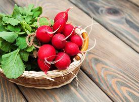 image of radish  - Fresh organic radish on a old wooden background - JPG