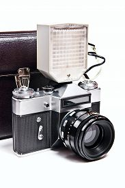 picture of flashing  - Old range finder vintage photo camera with flash isolated on white - JPG