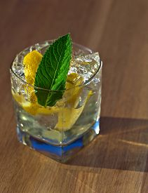 stock photo of peppermint  - cocktail with lemon ice and peppermint leaves - JPG