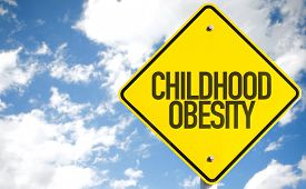 picture of obese children  - Childhood Obesity sign with sky background - JPG