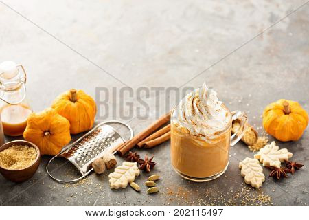 poster of Pumpkin spice latte in a glass mug with cinnamon, nutmeg and cookies