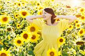 Freedom Concept. Summer Girl. Beautiful Cheerful Young Woman  With Sunflower Enjoying Nature And Lau poster