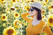 Summer Gir On Hat And Sunglasses. Beautiful Cheerful Young Woman With Sunflower Enjoying Nature And poster