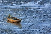 foto of swales  - A wooden boat in beach - JPG