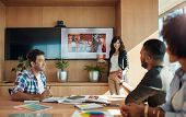 Female Coworker Making Presentation In Office poster