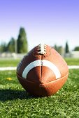 stock photo of football field  - An american football on a football field - JPG
