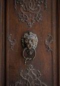 The Old Door Knocker On A Wooden Door poster