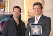 HOLLYWOOD - JAN 13: Colin Firth & Guy Pearce, actor Colin Firth receives star on walk of fame on Jan