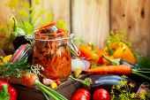 Homemade preserved from eggplant with vegetables in glass jar -ratatouille. Fall preserved vegetaria poster