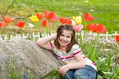 Girl Smiling In Front Of Flowe