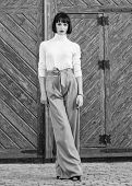 Woman Walk In Elegant Outfit. Fashion And Style Concept. Woman Fashionable Brunette Stand Outdoors W poster