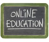 stock photo of online education  - online education text  in white chalk handwriting on a vintage slate blackboard - JPG