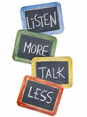 listen more, talk less - communication concept or advice - white chalk handwriting on small slate bl