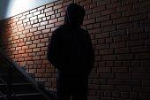 Silhouette Of Mysterious Man In Hoodie Indoors. Dangerous Criminal poster