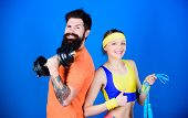Sport Instructor. Healthy Lifestyle Concept. Man And Woman Exercising With Dumbbell And Jumping Rope poster