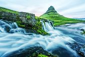 Incredible landscape with Kirkjufellsfoss waterfall and Kirkjufell mountain, Iceland, Europe. poster