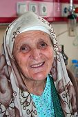 image of old lady  - Old lady looking and smiling at hospital - JPG