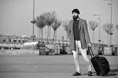 Hipster Ready Enjoy Travel. Carry Travel Bag. Business Trip. Man Bearded Hipster Travel With Big Lug poster