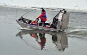 picture of airboat  - Airboat on the river in the winter time - JPG