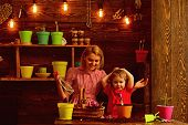 Kid Concept. Happy Kid Potting Plants With Mother. Kid Learn Planting Flower In Pot With Soil. Littl poster