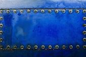 Industrial Background Texture With Blue Metal With Bolts And Rivets. Metal Plate Texture With Screws poster