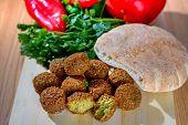 Falafel Balls, Sweet Red Pepper , Pita-arabian Bread And Green Fresh Parsley  On Wood Rustic Backgro poster