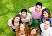 stock photo of latin people  - Group of young people smiling at the park - JPG