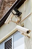 Security Camera And Reflector On The Wall Of A House And The Building, Close Up. Security Home Camer poster