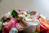 Wedding Rings On The Bouquet Of Roses. Wedding Rings On Bridal Bouquet With Colorful Roses. Bouquet  poster