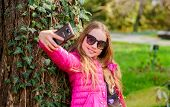 Nice Selfie. Little Girl Spend Free Time In Park. Happy Child In Park. Summer. Natural Beauty. Child poster