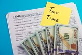 U.s. Individual Income Tax Return. Tax Deductions And Individual Tax Return Form 1040 With Money On  poster