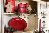 foto of taper  - Bright and cheery red pottery with christmas greenery - JPG