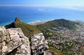 image of mountain lion  - A panoramic view of Lions Head, Signal Hill, Robben Island, and Cape Town, South Africa, as seen from the top of Table Mountain, a UNESCO World Heritage Site.