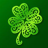 stock photo of triskele  - Ornate green cut out paper clover - JPG