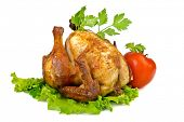 picture of spit-roast  - Roasted whole chicken on lettuce leaf with vegetables - JPG