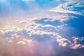 stock photo of time flies  - Sunrise above clouds during a flight bright light and colors - JPG
