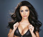 stock photo of breast exposed  - sexy dark haired girl with blue eyes and black bra - JPG