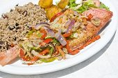 image of red snapper  - Cooked whole red snapper served with rice salad and vegetables - JPG