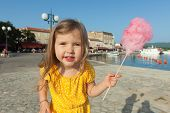 picture of candy cotton  - Pretty little girl eating candy floss - JPG