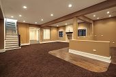picture of basement  - Lower level basement in earth tones and marble fireplace