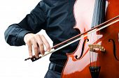 stock photo of cello  - Hands playing cello at the concert - JPG