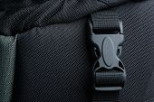 foto of sling bag  - Black plastic buckle with strap on backpack - JPG